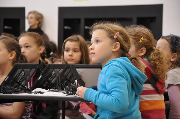 """3rd-5th grade students listen to instructions prior to using an """"Angry Birds"""" app on their iPads to learn how to program."""