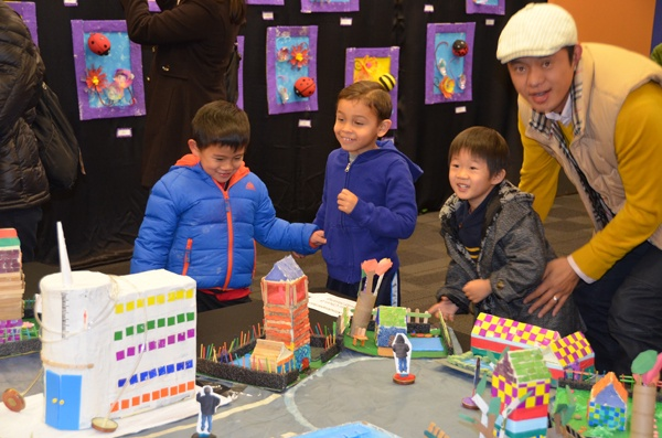 Students admire the village created by Yihui and David's class.