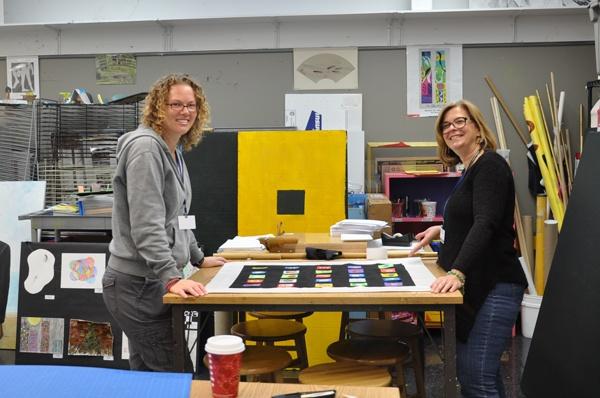 2013 Arts Night CHair, Kristin Lèfevre (left), assisted by parent volunteer and Trustee, Terri Kalia.